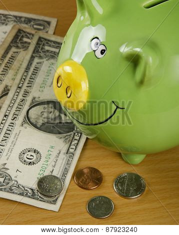 Piggy bank and US coin