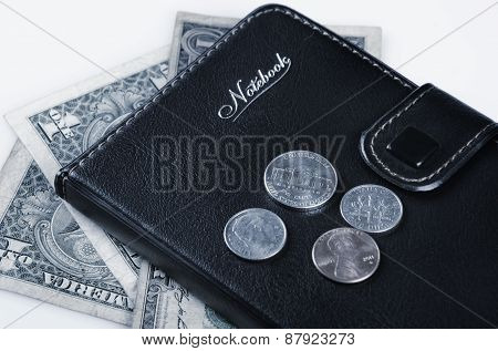 US coins and notebook