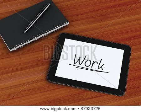 office working desk with laptop and notepad.