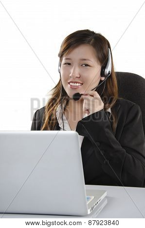 Confident female customer service agent with headset