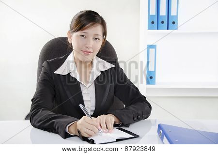 Businesswoman working on her desk