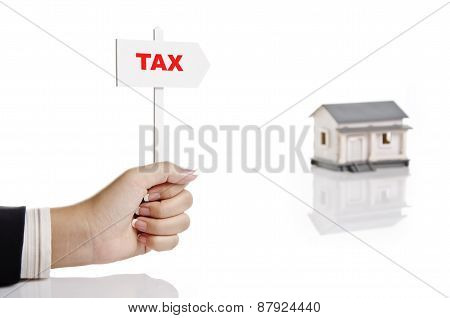 holding real estate sign