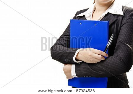 a business woman hugging note pad and holding a pen