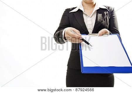 business woman pointing to note pad