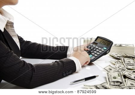 business woman pressing a calculator