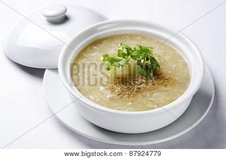 crab soup in a big white pod