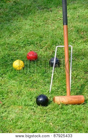 Croquet mallet with balls