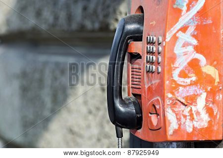 Old Payphone On A Stone Wall