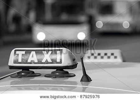 Emblem Taxi In Monochrome Tones