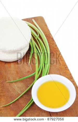 diet products : salted greek feta white cheese on wood with olive oil in saucer isolated over white background