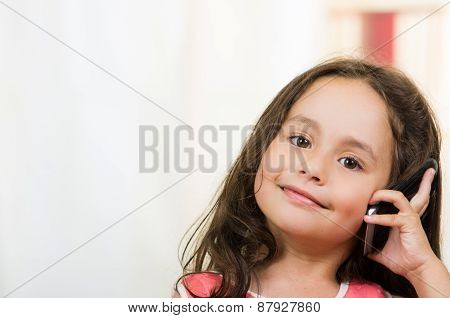 cute little girl using cell phone