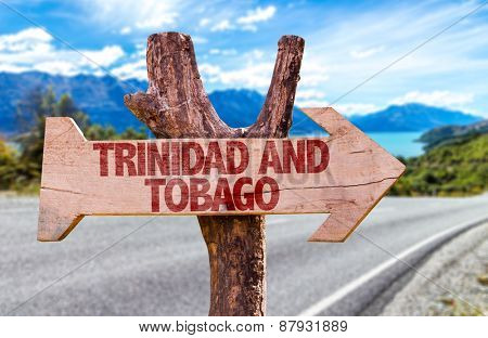 Trinidad and Tobago wooden sign with road background
