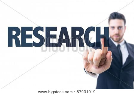 Business man pointing the text: Research