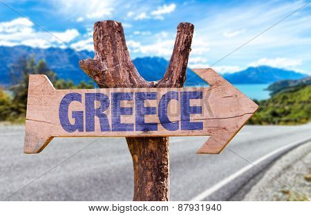 Greece wooden sign with road background