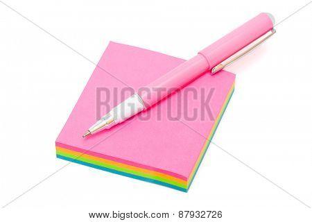 pen on sticky note on a white background