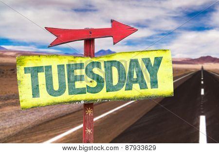 Tuesday sign with road background
