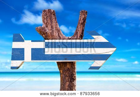 Greece Flag wooden sign with beach background
