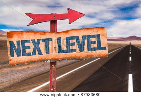Next Level sign with road background