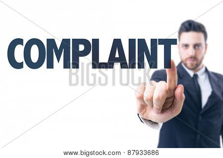 Business man pointing the text: Complaint