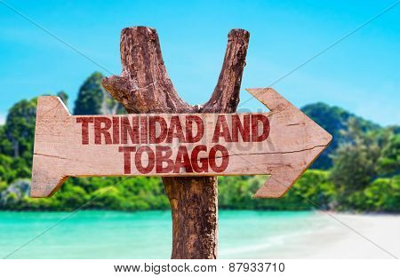 Trinidad and Tobago wooden sign with beach background