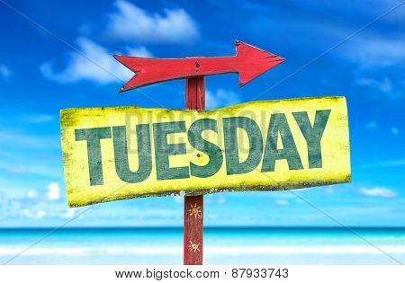 Tuesday sign with beach background