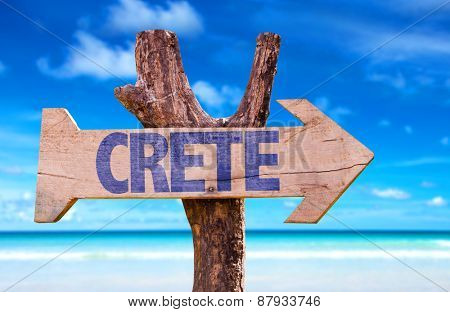 Crete wooden sign with beach background