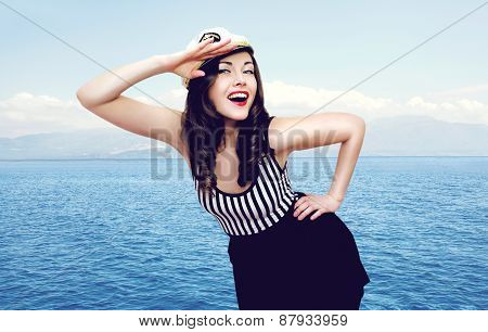 Travel, Cruise, Tourism And People Concept - Pretty Smiling Sailor Woman Saluting Against The Sea