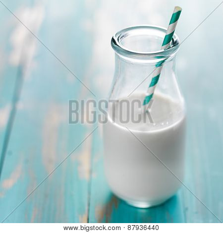 milk in retro glass with stripped staw and copy space
