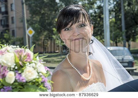 Young bride posing for the camera outside