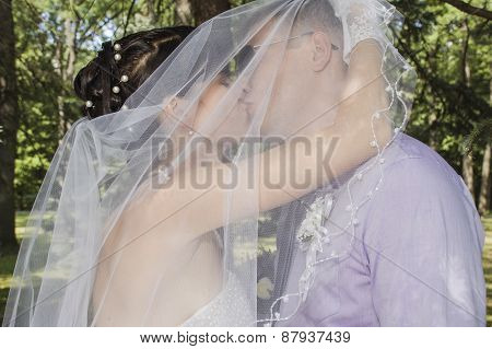 Young married couple posing for the camera outside