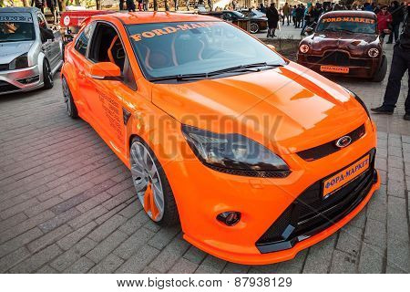 Orange Sporty Ford Focus Car Stands Parked On The Street