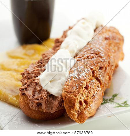 Delicious Dessert - Eclair with Caramel Banana and Ice Cream