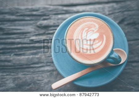 Latte Art, Blue Coffee Cup On Wooden Background With Vintage Colour Effect.