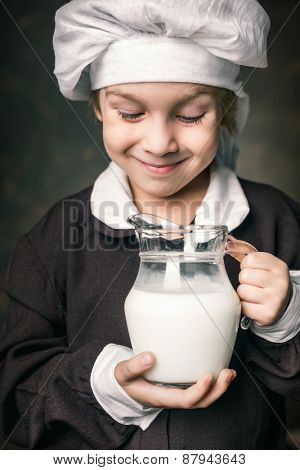 milkman boy holding a glass of milk