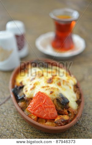 Turkish dinner with moussaka and tea