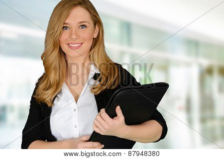 Young successful woman holding file holder