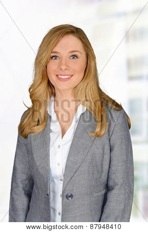 Young happy business woman looking at the camera