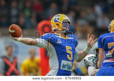 GRAZ, AUSTRIA - APRIL 26, 2014: QB Christoph Gubisch (#5 Giants) passes the ball.