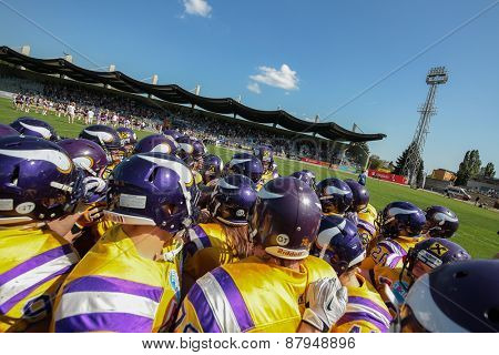 VIENNA, AUSTRIA - APRIL 27, 2014: The team of the Vienna Vikings in the huddle before the game.