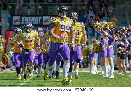 VIENNA, AUSTRIA - APRIL 27, 2014: DL Harald Zipfelmayer (#99 Vikings) leads the team of the Vienna Vikings into the stadium.