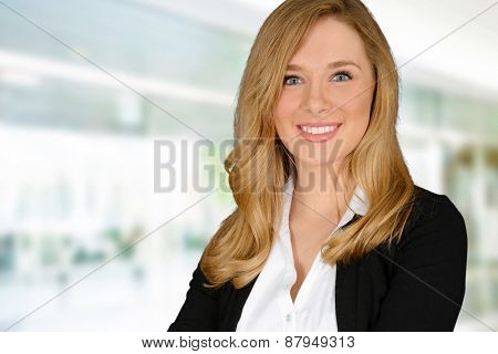 Young, blonde, blue eyed woman looking at the camera