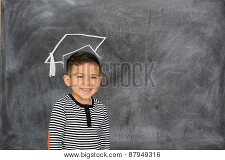 Child at school in front of blackboard