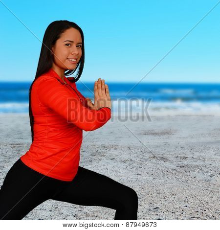 Woman who is exercising at the beach