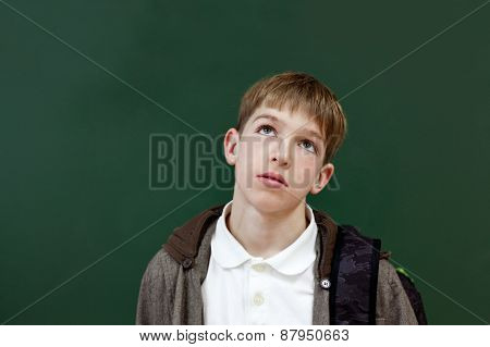 Portrait Of Student At Blackboard Background