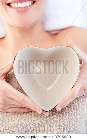 Close-up Of A Woman Holding A Bowl In The Shape Of A Heart