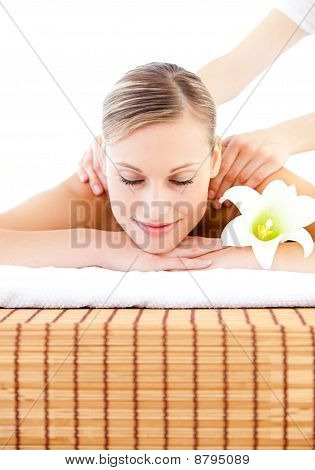 Portrait Of An Attactive Young Woman Receiving A  Massage