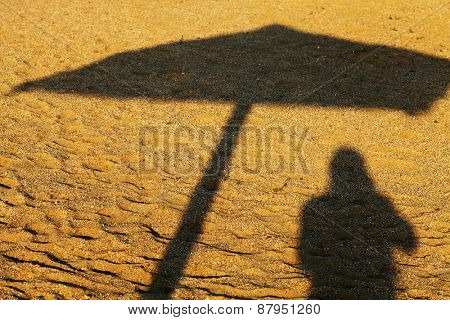 Shadow of a beach umbrella