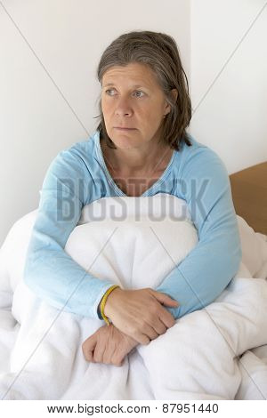 Sad Woman Sitting In Bed