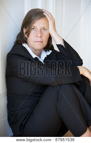 Businesswoman Sitting Depressed In Corner