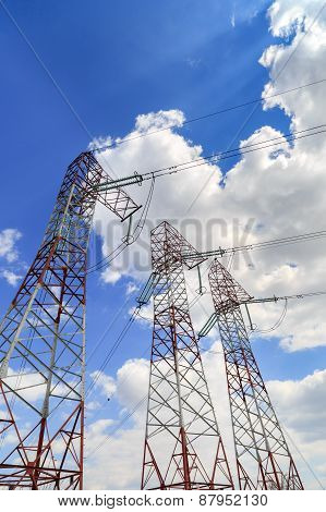 A High Voltage Power Pylons Against Blue Sky